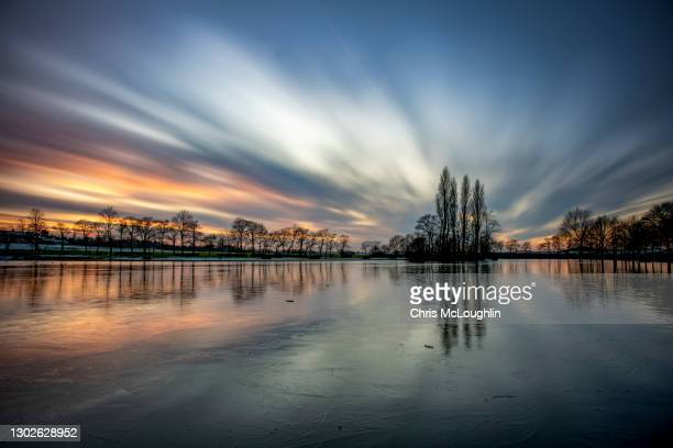 sunset on the lake at pontefract race course - long exposure stock pictures, royalty-free photos & images