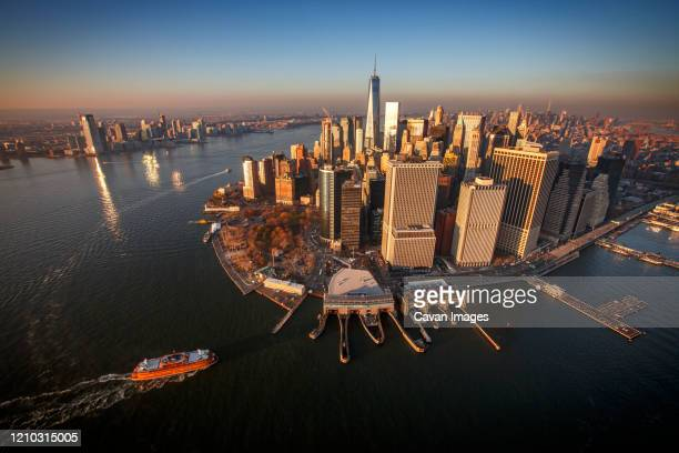 sunset on the manhattan skyline and financial district, new york city - new york harbour stock pictures, royalty-free photos & images