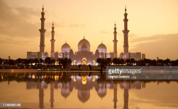 sunset on the mosque of abu dhabi - martial stock pictures, royalty-free photos & images