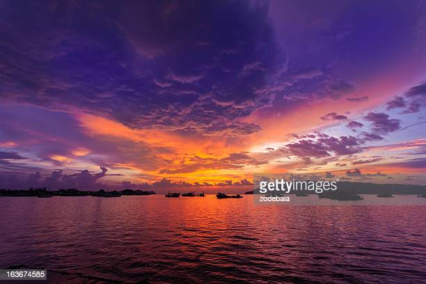 sunset on the ocean and fishing boats - kota kinabalu stock pictures, royalty-free photos & images