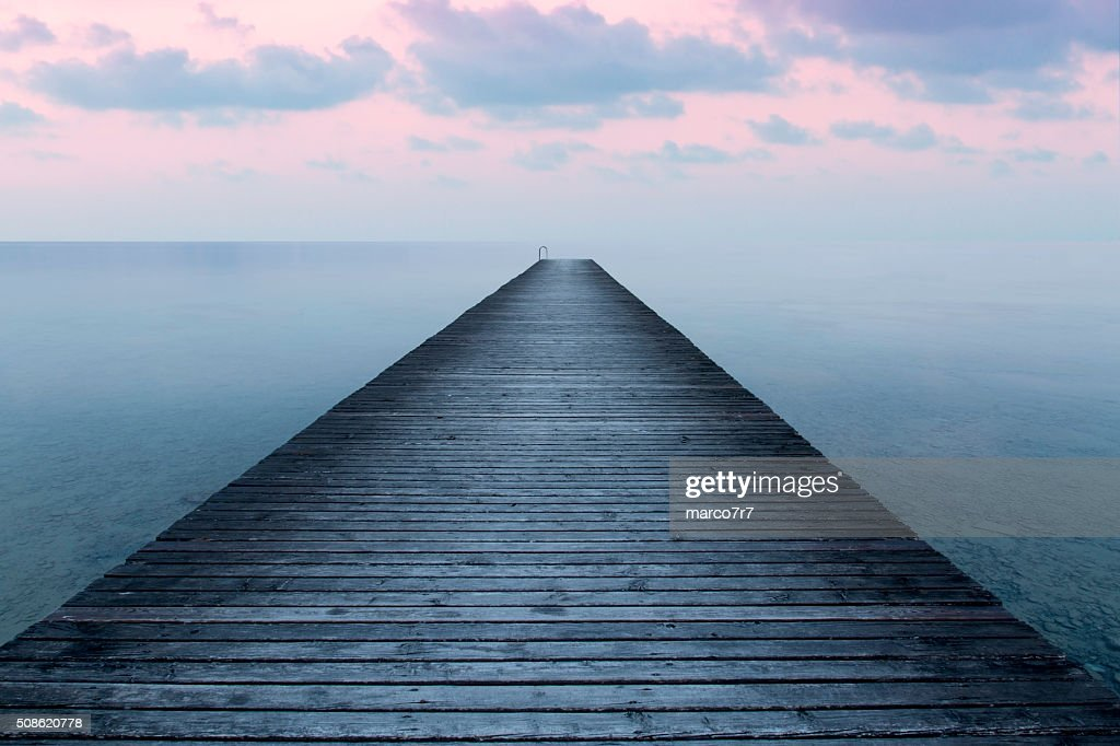 Sunset on the old pier : Stock Photo
