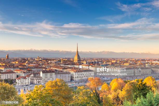 sunset on the old town of torino(turin) - turin stock pictures, royalty-free photos & images