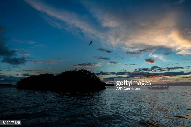 """Sunset on the Pacific Ocean in the Uramba Bahia Malaga national natural park in Colombia, on July 14, 2017. Uramba Bahia Malaga is part of the """"Hot..."""