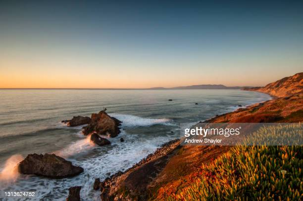 sunset on the pacific ocean south of san francisco. - san andreas fault stock pictures, royalty-free photos & images