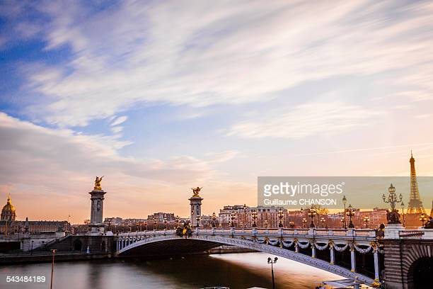 sunset on the pont alexandre iii - les invalides quarter stock photos and pictures