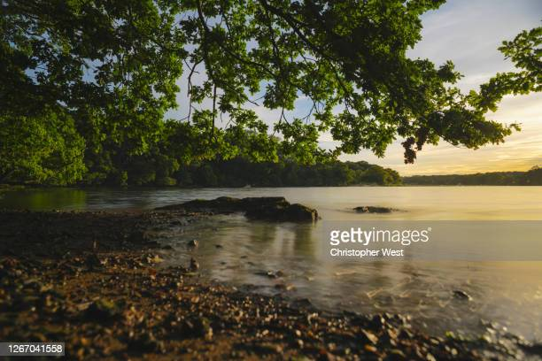 sunset on the river hamble - southampton england stock pictures, royalty-free photos & images