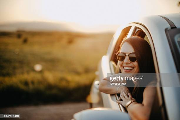 sunset on the road - driving stock pictures, royalty-free photos & images