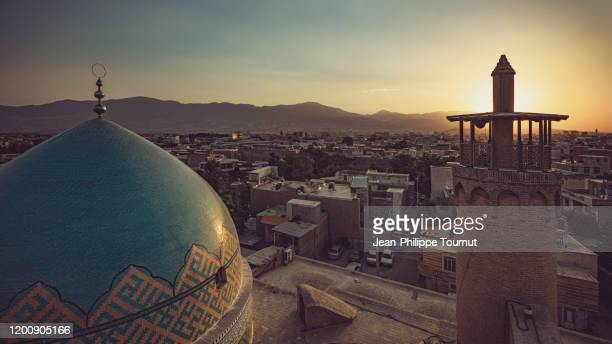 sunset on the roof of one of the oldest mosque of iran, masjid-e-jameh, jameh mosque of borujerd, lorestan province, iran - iran stock pictures, royalty-free photos & images