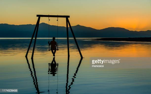 sunset on the salton sea - installation art stock pictures, royalty-free photos & images