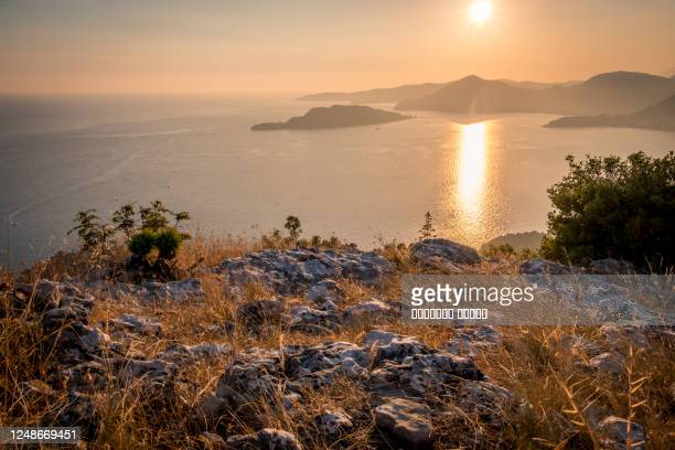 sunset on the sea among the beautiful mountains, the adriatic sea. montenegro. - kotor bay stock pictures, royalty-free photos & images
