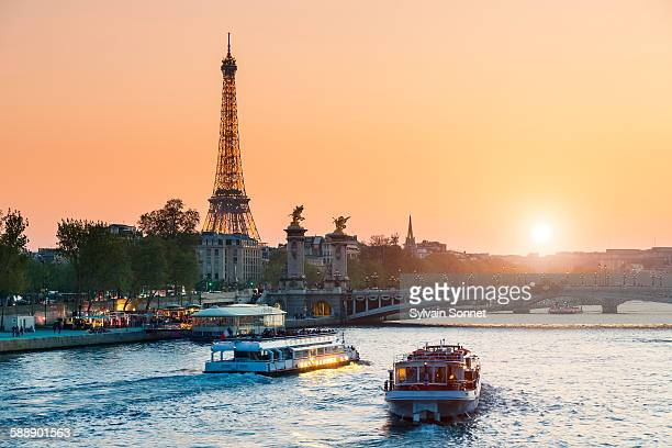 sunset on the seine river - eiffel tower stock photos and pictures
