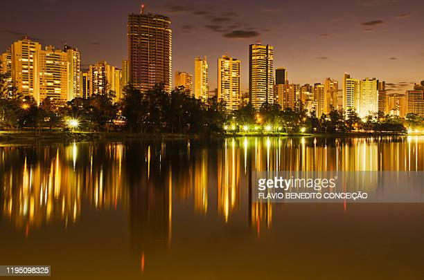 sunset on the shores of lake igapó in the city of londrina with the apartment buildings in the back, city of londrina was colonized by the english. - parana state stock pictures, royalty-free photos & images