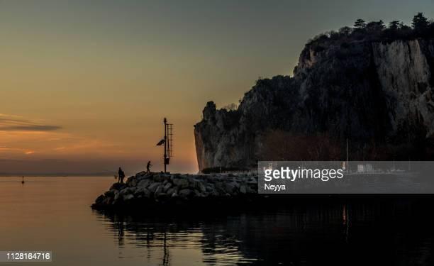 Sunset on the Sistiana Bay in Adriatic Sea, Italy