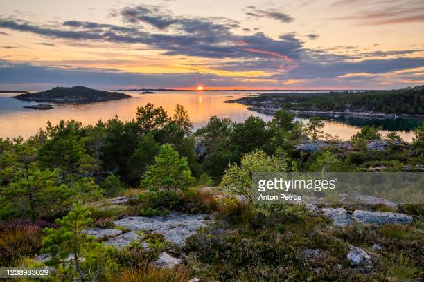 sunset on the swedish coast. - sweden stock pictures, royalty-free photos & images