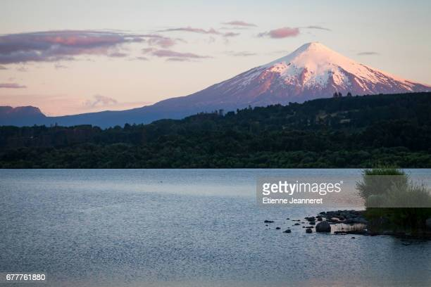 sunset on the volcano, villarica, chile, 2013 - villarrica stock photos and pictures