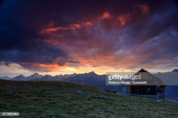 Sunset on the wooden hut Muottas Muragl Switzerland