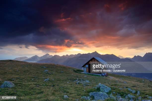 Sunset on the wooden hut Muottas Muragl Switzerland