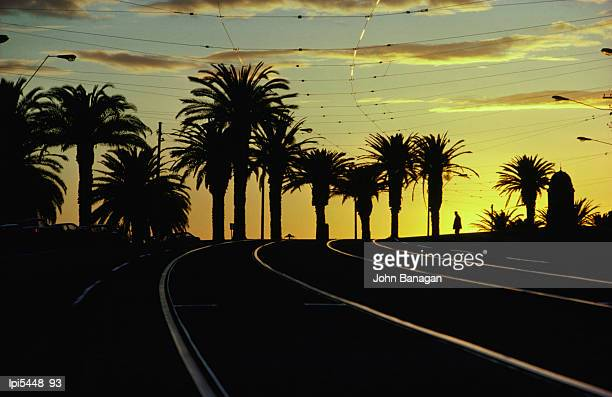Sunset on tram tracks of St Kilda Esplanade, Low angle view, Melbourne, Australia
