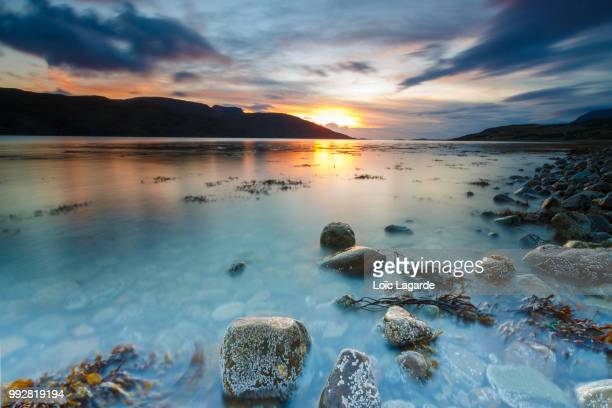 sunset on ullapool seafront - lagarde stock pictures, royalty-free photos & images