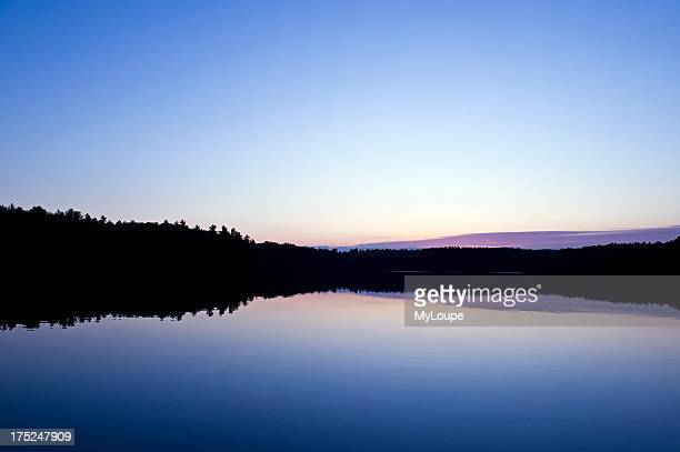 Sunset on Walden Pond made famous by Henry David Thoreau Concord MA Massachusetts