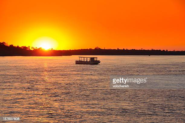 sunset on zambezi - zambezi river stock pictures, royalty-free photos & images