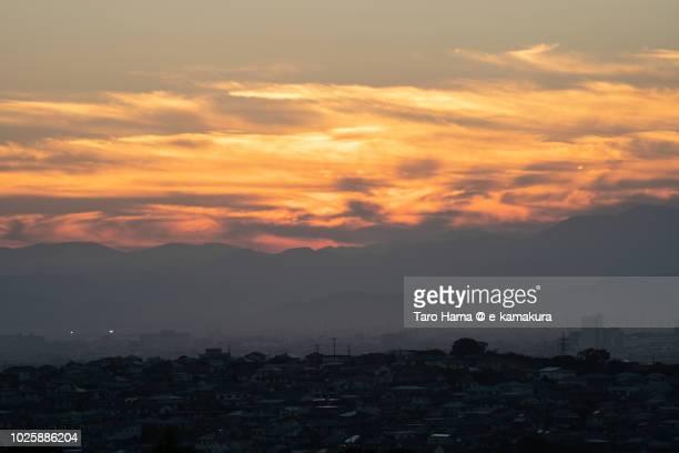 Sunset orange clouds on Mt. Tanzawa, and Kamakura, Fujisawa, Chigasaki and Hiratsuka cities in Kanagawa prefecture in Japan