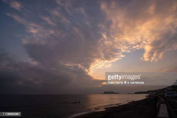 Sunset orange-colored clouds on Enoshima Island in Fujisawa city and the beach in Kamakura city in Kanagawa prefecture in Japan