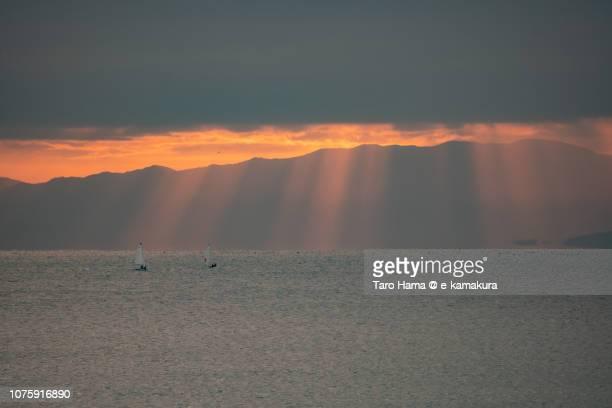 Sunset orange-colored sunset beam on Sailing yachts on Sagami Bay and Izu Peninsula in Japan