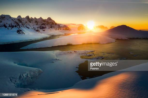 sunset ove port lockroy - antarctica stock pictures, royalty-free photos & images