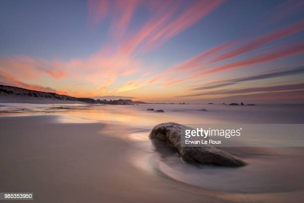 Sunset over a beach in Kerlouan, Brittany, France.