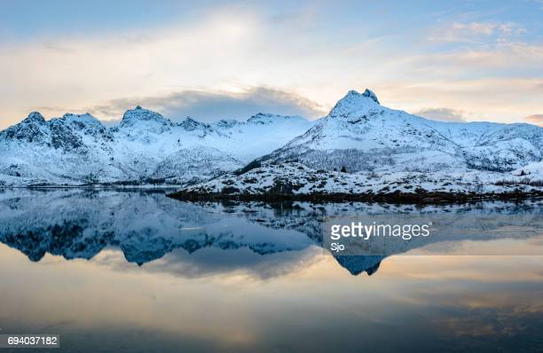 """sunset over a calm winter lake in the lofoten in norway - """"sjoerd van der wal"""" or """"sjo"""" stock pictures, royalty-free photos & images"""