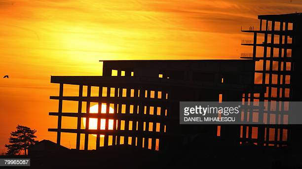 Sunset over a construction site in Pristina on February 24 seven days after Kosovo's parliament declared the province's independence from Serbia...