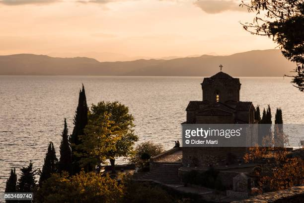 sunset over a famous church in ohrid in macedonia - lake ohrid stock photos and pictures