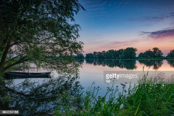 sunset over a lake in nature during spring - overijssel stock pictures, royalty-free photos & images