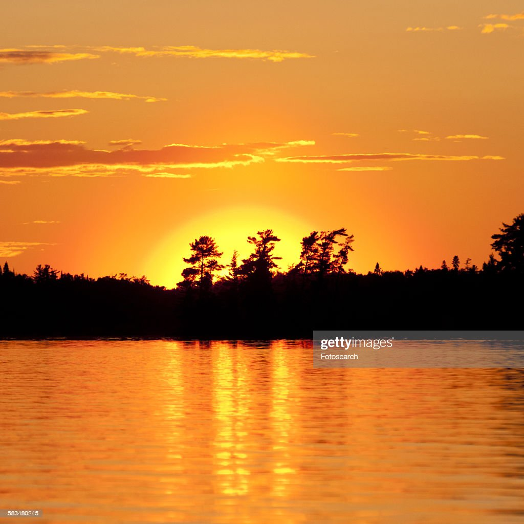 Sunset over a lake : Stock Photo