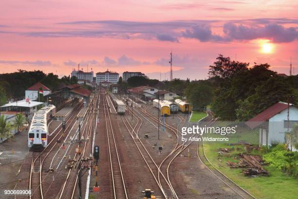 sunset over a railway station - yogyakarta stock photos and pictures