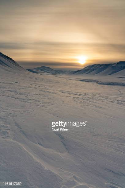 sunset over adventdalen, svalbard - northern europe stock pictures, royalty-free photos & images