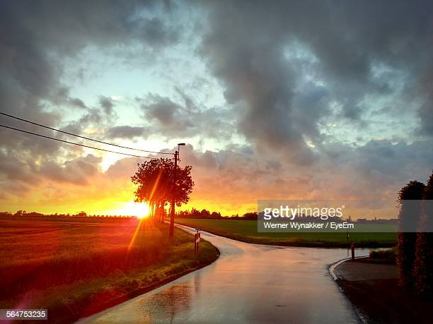 Sunset Over Agricultural Field During Rainy Season