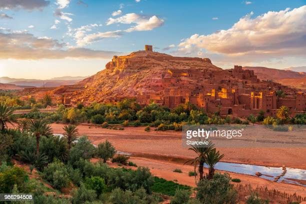 sunset over ait benhaddou - ancient city in morocco north africa - morocco stock pictures, royalty-free photos & images