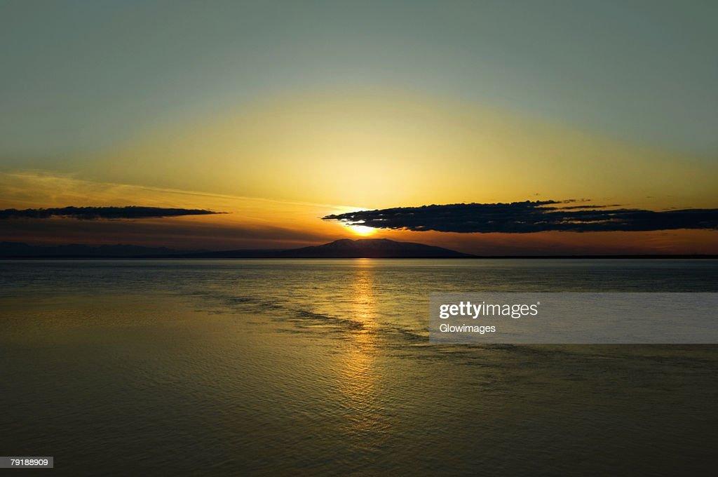 Sunset over an island, Fire Island, Anchorage, Alaska, USA : Stock Photo
