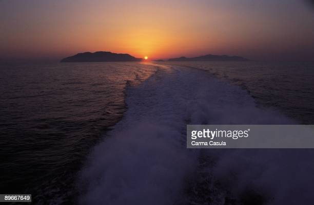 Sunset over an island Panoramic view from a ship of the evening on an island of the Lipari or Eolas to the North of Sicily