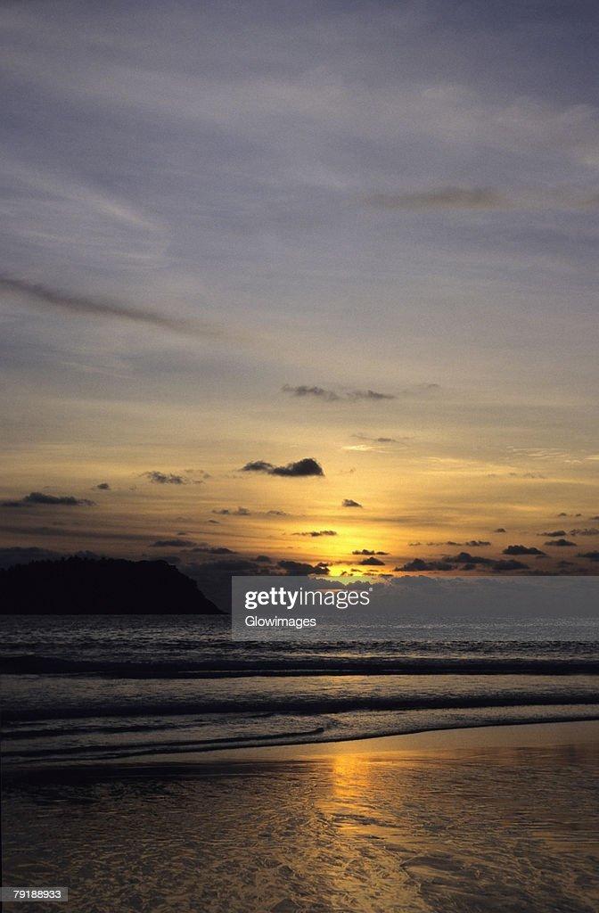 Sunset over an island, Phi Phi Islands, Andaman Sea, Thailand : Stock Photo