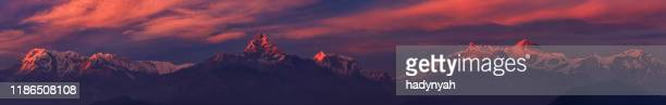 sunset over annapurna range, nepal - annapurna south stock pictures, royalty-free photos & images