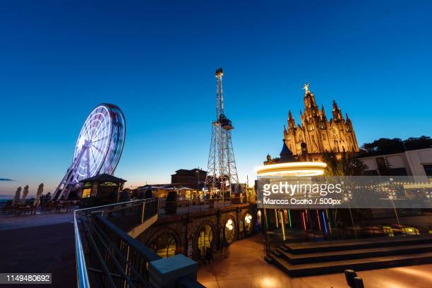 sunset over barcelona landamark - tibidabo stock pictures, royalty-free photos & images