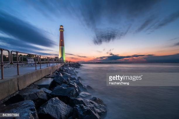 sunset over barnegat lighthouse - new jersey stock pictures, royalty-free photos & images