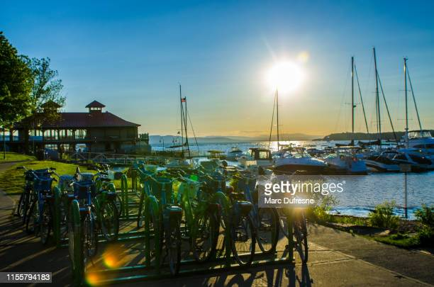 sunset over bikes and boats - burlington vermont stock photos and pictures