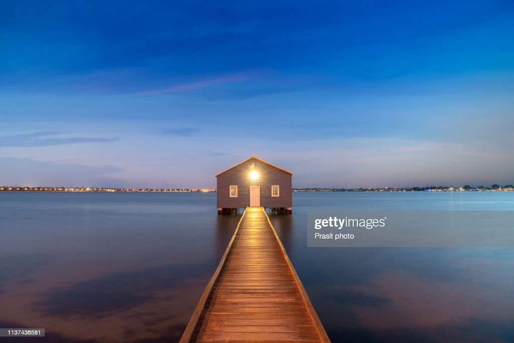 Sunset Over Blue Boathouse In The Swan River In Perth Western
