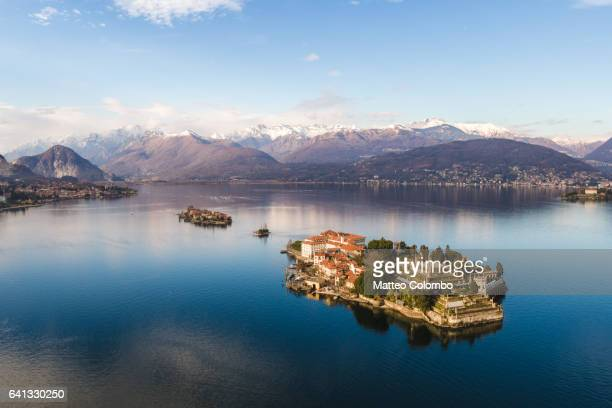 sunset over borromeean islands, lake maggiore, italy - stresa stock pictures, royalty-free photos & images
