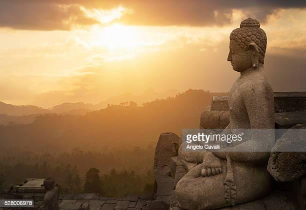 Sunset over Buddhist temple, Borobudur, Java, Indonesia