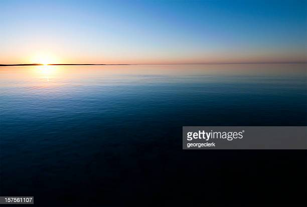 Sunset Over Calm Water